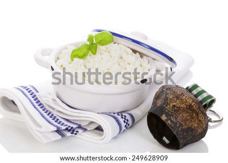 Fresh traditional curd on kitchen towel isolated on white background. Traditional curd, milk product. - stock photo
