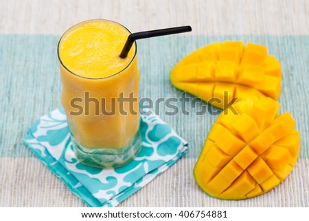 Fresh tropical fruit smoothie mango juice and fresh mango on a outdoor tropical background  - stock photo