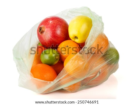 Fresh tropical fruits Apples in plastic bag isolated in white. - stock photo