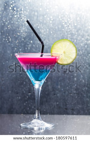 Fresh tropical layered cocktail  - stock photo