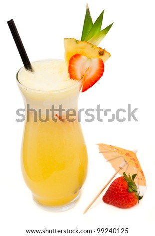 fresh tropical pina colada cocktail served in a pineapple - stock photo