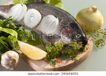 fresh trout prepared for cooking - stock photo