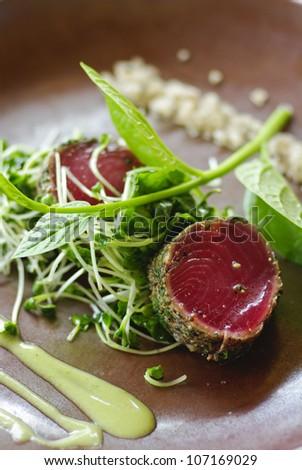 Fresh tuna meat sliced on ceramic dish - stock photo