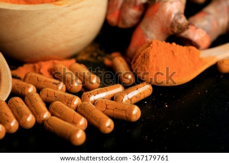 fresh turmeric with capsules