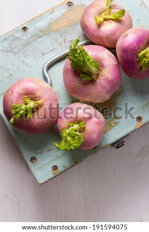 Fresh turnips on an old wooden box - stock photo