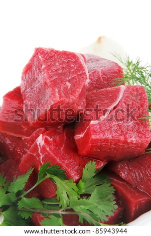 fresh uncooked beef meat slices over white bowls ready to prepare with green hot peppers and greenery isolated over white background - stock photo