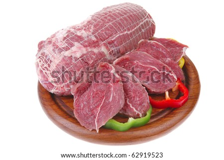 fresh uncooked meat chunk on  wooden board - stock photo