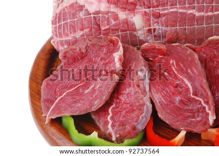 fresh uncooked meat chunk on  wooden board