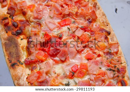 Fresh uncooked raw ham and cheese pizza