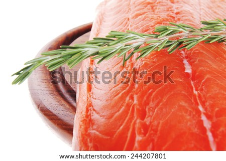 fresh uncooked salmon fillet with rosemary on wood - stock photo