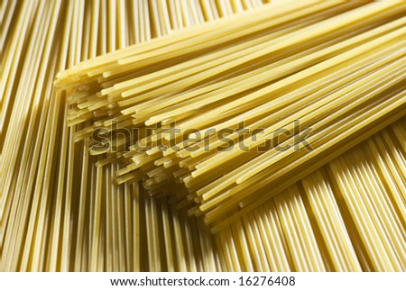 fresh uncooked spaghetti background close up shoot