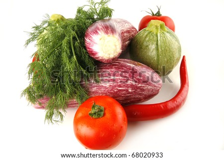 fresh uncooked vegetables served on white background
