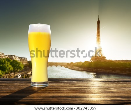 fresh  unfiltered beer and Eiffel tower, Paris, France - stock photo