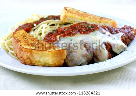 Fresh Veal Parmesan - fresh breaded veal topped with marinara sauce with spaghetti and garlic toast.