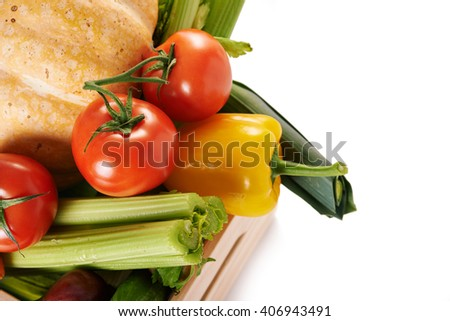 fresh vegatables in crate isolated on white background