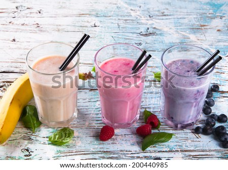 Fresh vegetable and fruits juices on sand background. Carrot, beetroot and orange fresh juice. Organic, bio drink. Summer concept. - stock photo