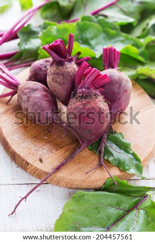 Fresh vegetable beetroots on white wooden background. Selective focus. Rustic style.