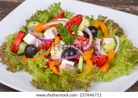 Fresh vegetable colorful greek salad in pate, close up - stock photo