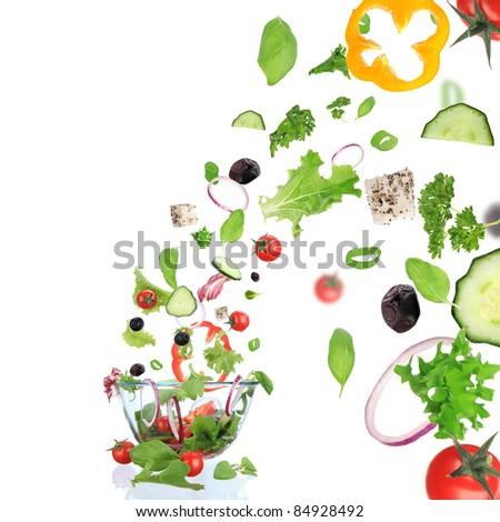 Fresh vegetable in motion. - stock photo