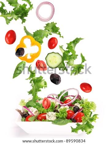 Fresh vegetable in motion over white - stock photo