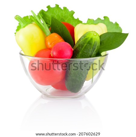 Fresh vegetable in transparent bowl isolated on white background - stock photo