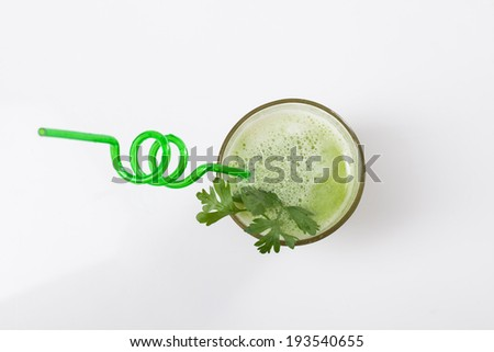 fresh vegetable juice in green transparent glass - stock photo