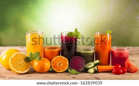 Fresh vegetable juices on wood plant - stock photo
