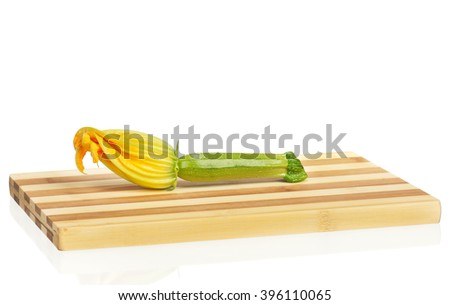 Fresh vegetable marrow on a chopping board isolated over white background - stock photo