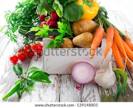Fresh vegetable on wooden background - stock photo