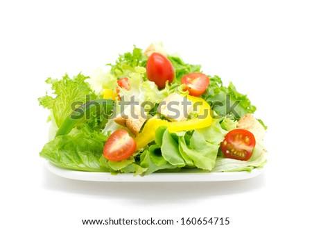 Fresh vegetable salad isolated on white. - stock photo