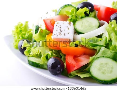 fresh vegetable salad isolated on white background - stock photo