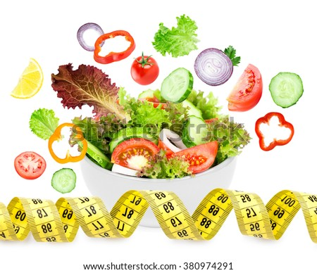 Fresh vegetable salad on white background. Diet concept. Healthy food - stock photo