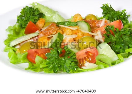 Fresh vegetable salad with bacon on white background
