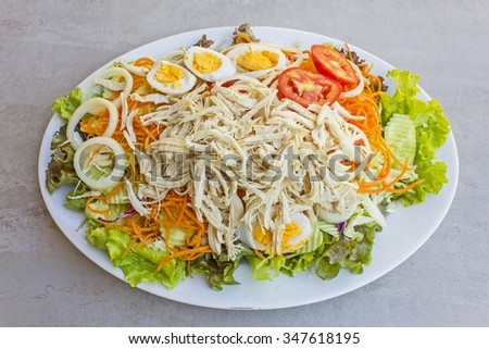 Fresh vegetable salad with chicken on a tile surface - very Big size salad - mix style