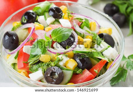 Fresh vegetable salad with corn and feta cheese - stock photo