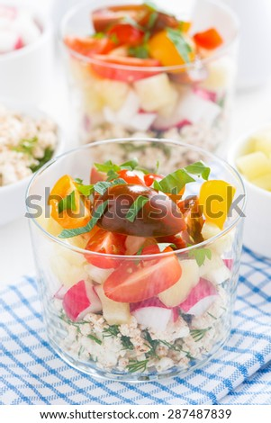 fresh vegetable salad with cottage cheese in a glass, vertical, top view