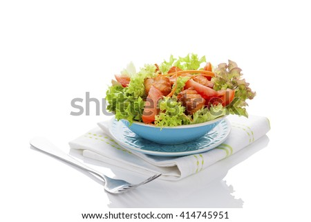 Fresh vegetable salad with roasted salmon pieces. Delicious healthy salad eating.  - stock photo