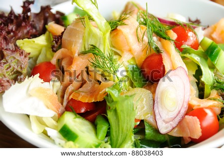 Fresh vegetable salad with smok salmon fish