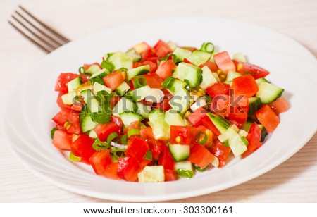 fresh vegetable salad with tomato, cucumber and green onion - stock photo