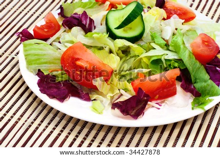 Fresh vegetable salad with tomato, lettuce, cucumber