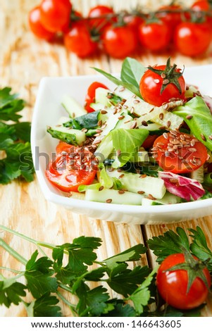 fresh vegetable salad with tomatoes and cucumbers, close up