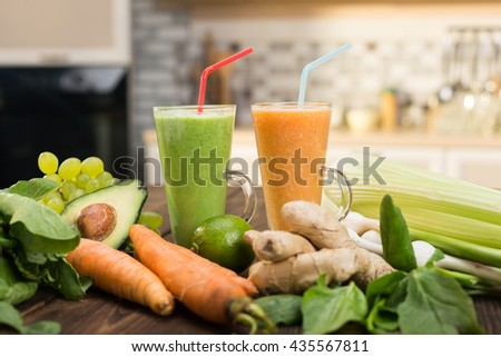 Fresh vegetable smoothies on wooden kitchen table
