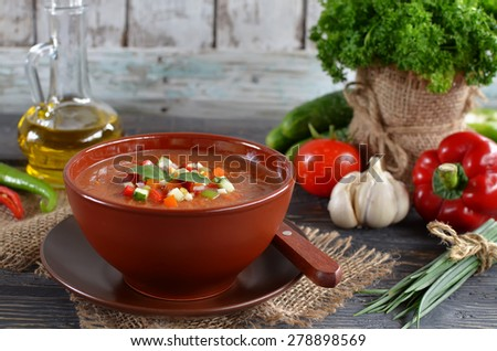 Fresh vegetable soup Gazpacho on the table. - stock photo