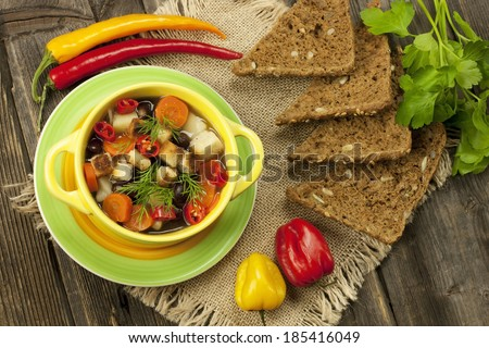 Fresh vegetable soup made of color bean, carrot, potato, red bell pepper, tomato in bowl