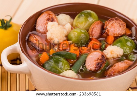 Fresh vegetable soup with sausage. Whole background.
