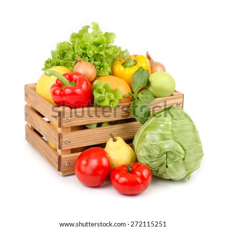 Fresh vegetables and fruit in a wooden box on a white background. - stock photo