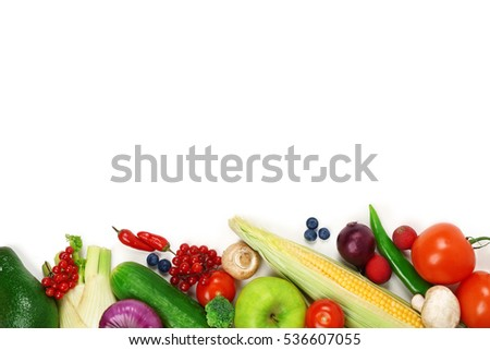 Fresh vegetables and fruit on white background