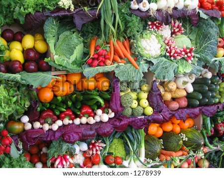 Fresh vegetables and fruits at a farmer's market - stock photo