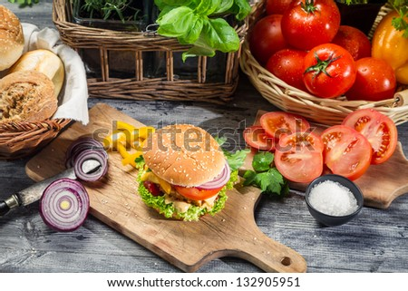 Fresh vegetables and herbs as ingredients for homemade hamburger - stock photo