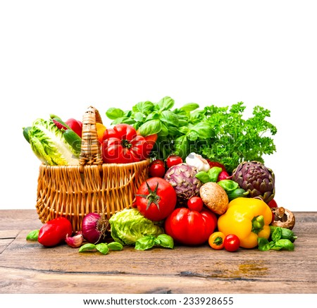 fresh vegetables and herbs in shopping basket. raw food ingredients - stock photo